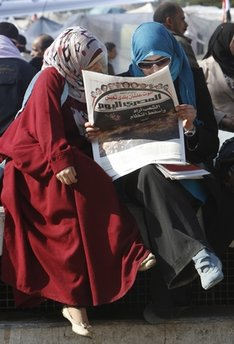 Egyptian women read Egyptian Today newspaper